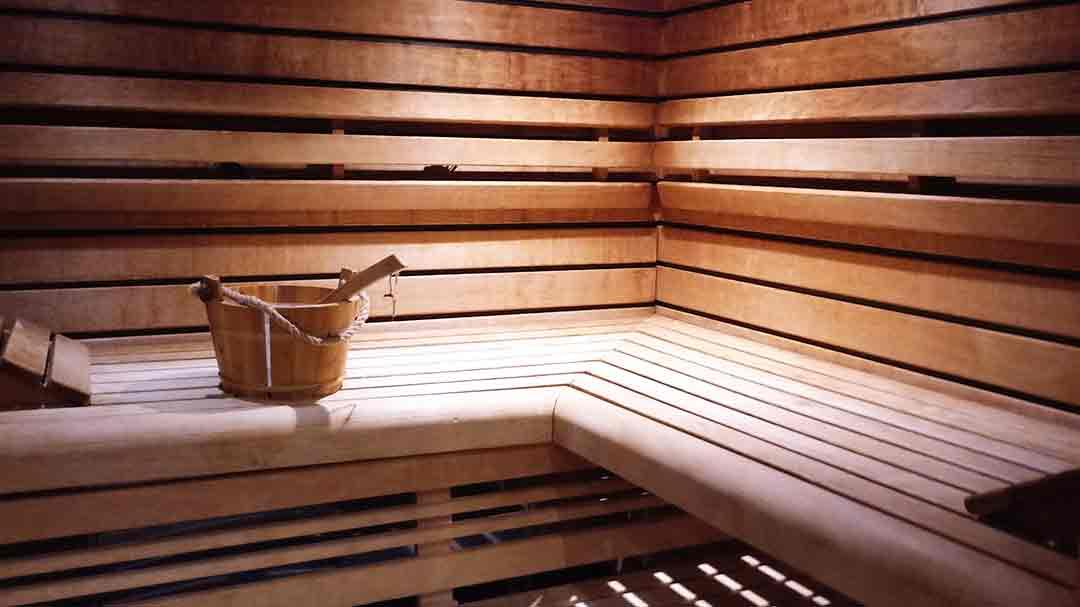 wood slat wall and seat of a sauna