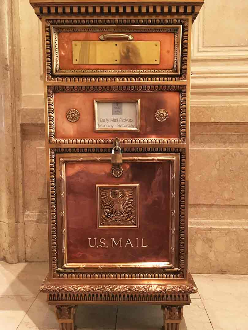 Burnished copper and wood mailbox
