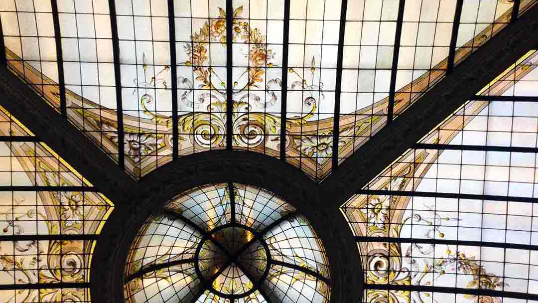 detail of ornate iron and leaded glass ceiling in the Hotel Vernet